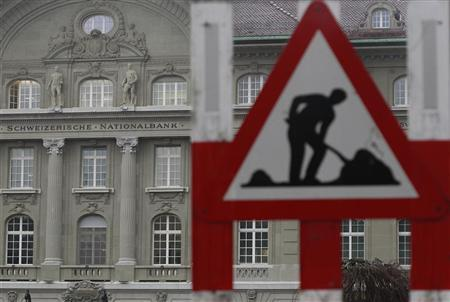 A safety construction sign stands outside the Swiss National Bank (SNB) building in Bern April 5, 2012. REUTERS/Pascal Lauener