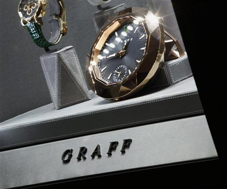 Luxury clocks and watches are displayed inside a Graff Diamonds store at Peninsula Hotel in Hong Kong in this November 22, 2011 file photo. REUTERS/Bobby Yip/Files
