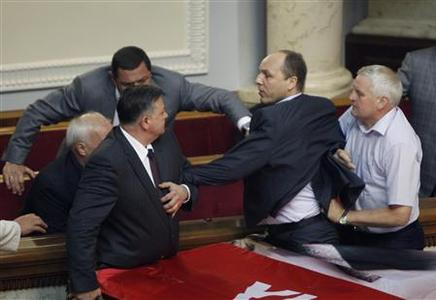 Deputies scuffle during a session in the chamber of the Ukrainian parliament in Kiev June 5, 2012. A crowd of Ukrainians, angry over a parliamentary vote that would increase the role of the Russian language in the country, clashed with police on Tuesday at a ''fan zone'' set up in the capital Kiev for the Euro 2012 soccer championship. REUTERS/Gleb Garanich
