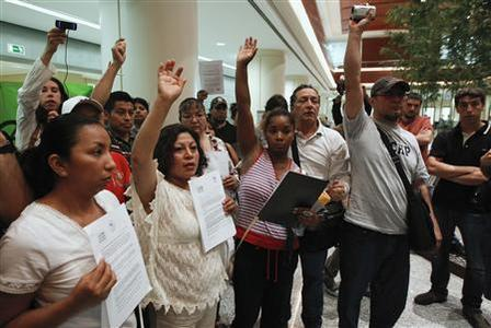 Demonstrators protest against evictions inside a branch of nationalized lender Bankia in Madrid, June 8, 2012. REUTERS/Andrea Comas
