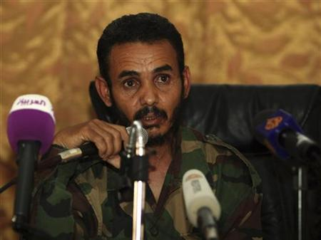 Alajmi Ali Ahmed al-Atiri, the head of the brigade which captured Muammar Gaddafi's son Saif al-Islam, addresses the media in Zintan June 9, 2012. A delegation for the International Criminal Court has been detained in Libya after one of its lawyers was found to be carrying suspicious documents for Saif al-Islam, a Libyan lawyer and a militia said on Saturday. REUTERS/Ismail Zetouny