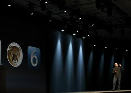 REFILE - CORRECTING TYPO IN NAME Apple Inc CEO Tim Cook speaks from onstage during the Apple Worldwide Developers Conference 2012 in San Francisco, California June 11, 2012. REUTERS/Stephen Lam