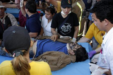 A dead Paraguayan peasant is seen at a health center in Curuguaty, 280 km (174 miles) northeast of Asuncion, following clashes with police, June 15, 2012. REUTERS/Stringer