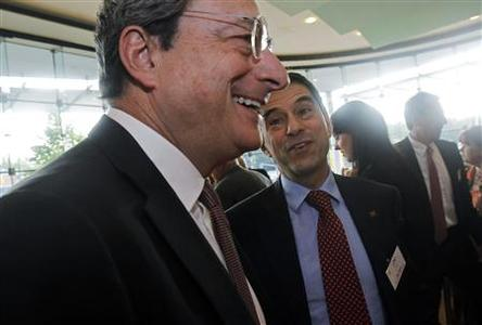 European Central Bank (ECB) President Mario Draghi (L) talks with Portugal's Finance Minister Vitor Gaspar as they arrive for a finance conference in Frankfurt June 15, 2012. REUTERS/Alex Domanski