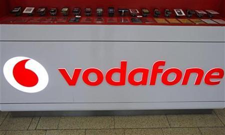 The Vodafone logo is seen at the counter of the shop in Prague February 7, 2012. British telecommunication firm Vodafone is expected to post fourth-quarter results on February 9. REUTERS/David W Cerny