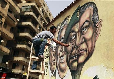 An artist paints a mural depicting the faces of former president Hosni Mubarak and Field Marshal Mohamed Hussein Tantawi in Cairo May 22, 2012. Painted on a wall on the edge of Cairo's Tahrir Square is a large portrait that illustrates how many view the man who has ruled Egypt since Hosni Mubarak was overthrown last year. Half the face is of the ousted president juxtaposed to the other portion showing Field Marshal Hussein Tantawi, the 76-year-old who was Mubarak's defence minister for 20 years. After ending Mubarak's 30-year rule 16 months ago, many feel they have replaced him with a carbon copy. Picture taken May 22, 2012. REUTERS/Suhaib Salem