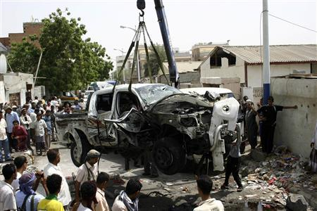 The car of a military commander is lifted after a suicide bomber blew himself up next to it killing the official in the southern Yemeni city of Aden June 18, 2012. The commander of military forces in the south of Yemen Major General Salem Ali Qatan was killed days after troops drove Islamist militants linked to al Qaeda from their southern strongholds. REUTERS/Stringer