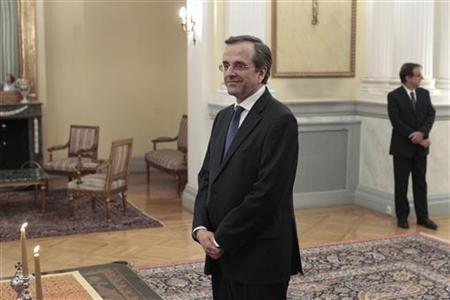 Newly appointed Greek Prime Minister Antonis Samaras smiles before a swearing in ceremony at the Presidential palace in Athens June 20, 2012. REUTERS/Yorgos Karahalis
