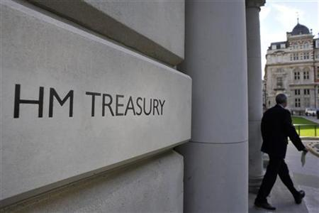 A man leaves the government Treasury buildings in Whitehall in central London October 19, 2010. REUTERS/Toby Melville