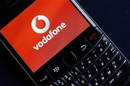 A Vodafone logo is seen on a Blackberry phone in London November 9, 2010. REUTERS/Suzanne Plunkett
