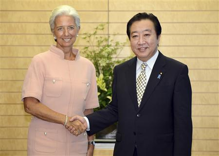 International Monetary Fund (IMF) Managing Director Christine Lagarde (L) shakes hands with Japan's Prime Minister Yoshihiko Noda during their talks at Noda's official residence in Tokyo July 6, 2012. REUTERS/Toru Yamanaka/Pool