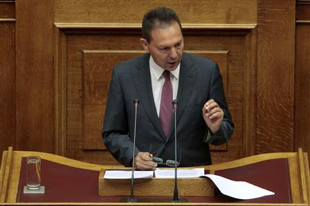 Greece's Finance Minister Yannis Stournaras addresses parliamentarians during a session at the parliament in Athens July 7, 2012. REUTERS/Yorgos Karahalis