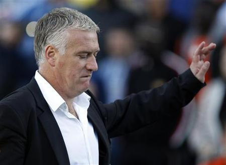Olympique Marseille's head coach Didier Deschamps salutes supporters as he leaves the pitch during his French Ligue 1 soccer match against Nancy at the Velodrome stadium in Marseille, May 2, 2012. REUTERS/Jean-Paul Pelissier