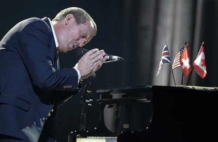 British singer and actor Hugh Laurie performs with his band during the 46th Montreux Jazz Festival in Montreux July 9, 2012. REUTERS/Denis Balibouse