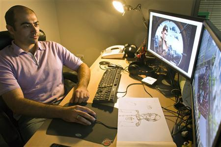 Plarium CEO Avi Shalel sits in his office in Herzliya near Tel Aviv July 10, 2012. Israel-based online games developer Plarium, whose multi-player game Total Domination has attracted 20 million users in just a year, expects revenue to double annually in coming years as it launches new games and enters new markets such as the United States.Picture taken July 10, 2012. REUTERS/Nir Elias