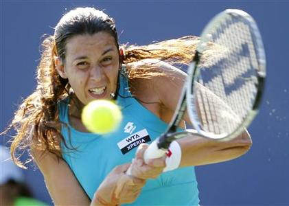 Marion Bartoli of France returns a shot during her match against Mallory Burdette of the U.S. at the Bank of the West Classic women's tennis tournament on the Stanford University campus in Palo Alto, California July 12, 2012. REUTERS/Robert Galbraith