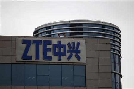 Employees of ZTE chat on the roof of its headquarters in Shenzhen, Guangdong province, in this April 17, 2012 file photo. REUTERS/Tyrone Siu/Files