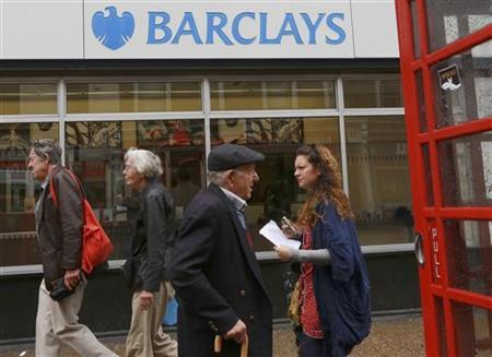 Shoppers pass a branch of Barclays Bank in west London on July 2, 2012. REUTERS/Olivia Harris