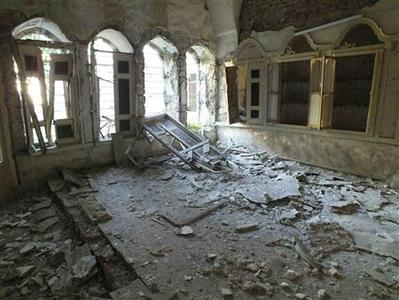 The interior of a destroyed house is pictured in Homs July 14, 2012. The Red Cross now views fighting in Syria as an internal armed conflict - a civil war in layman's terms - crossing a threshold experts say can help lay the ground for future prosecutions for war crimes. The independent humanitarian agency had previously classed the violence in Syria as localised civil wars between government forces and armed opposition groups in three flashpoints - Homs, Hama and Idlib. Picture taken July 14, 2012. REUTERS/Yazen Homsy