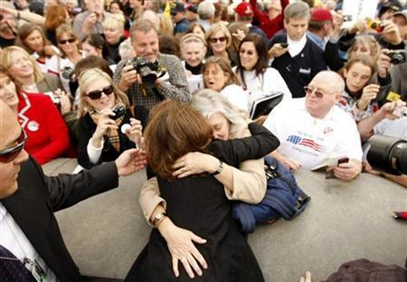 Minnesota Republican Representative Michele Bachmann gets a hug during a ''House Call'' rally against proposed healthcare reform legislation at the Capitol in Washington November 5, 2009. REUTERS/Kevin Lamarque