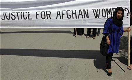 A woman marches with a banner to protest the recent public execution of a young woman, in Kabul July 11, 2012. REUTERS/Omar Sobhani