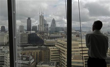 A man looks out at the view of London from the 14th floor of the Shard in London July 4, 2012. REUTERS/Luke MacGregor