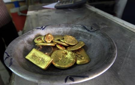 A pile of gold is pictured at a gold laboratory in the gold market in Khartoum July 15, 2012. REUTERS/Mohamed Nureldin Abdallah
