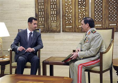 Syrian President Bashar al-Assad meets General Fahad Jassim al-Freij, after he was sworn as Defense Minister (R) in Damascus, in this handout photo distributed by Syrian News Agency (SANA) July 19, 2012. REUTERS/SANA/Handout