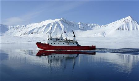 A ship travels on the Isfjorden near Longyearbyen on the Norwegian Svalbard islands, June 1, 2012. REUTERS/Balazs Koranyi