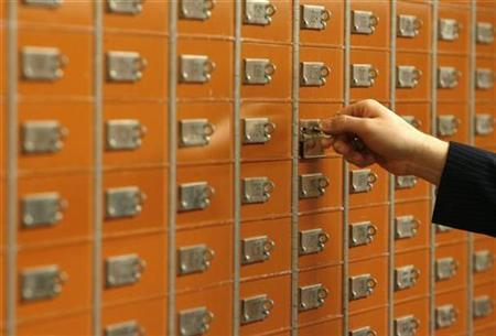 An employee checks a safe box in the vault of the Basler Kantonalbank (BKB) in Basel January 21, 2009. Picture taken January 21, 2009. REUTERS/Arnd Wiegmann