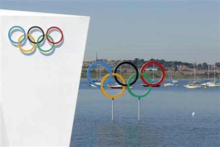 The Olympic rings are pictured ahead of the start of the London 2012 Olympic Games at the venue of the sailing competition in Weymouth and Portland, southern England, July 24, 2012. REUTERS/Benoit Tessier
