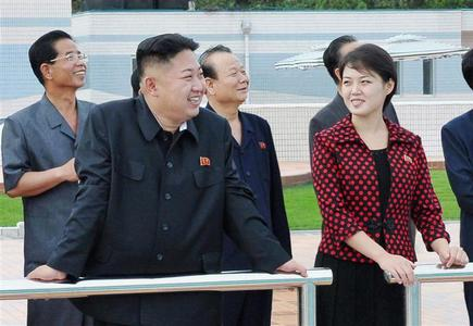 North Korean leader Kim Jong-Un and an unidentified woman visit the Rungna People's Pleasure Ground in Pyongyang in this undated picture released by the North's KCNA on July 25, 2012. Kim Jong-un has married, state media say, putting an end to speculation over the relationship with a woman seen at his side recently. REUTERS/KCNA