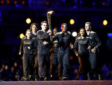 Seven young athletes carry the Olympic torch into the opening ceremony of the London 2012 Olympic Games at the Olympic Stadium July 27, 2012. REUTERS/Mike Segar