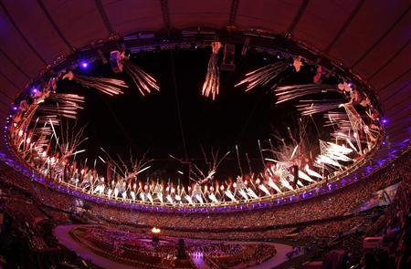 The Olympic cauldron is seen alight as fireworks are set off during the opening ceremony of the London 2012 Olympic Games at the Olympic Stadium July 27, 2012. REUTERS/Jorge Silva