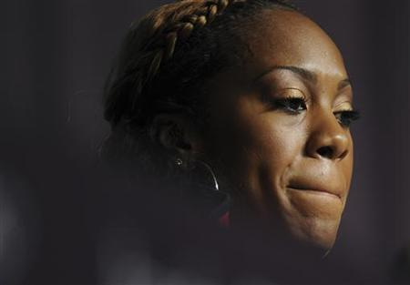 U.S. athlete Sanya Richards-Ross, who is competing in the 200m and 400m track events, reacts during a news conference at the London 2012 Olympics July 30, 2012. REUTERS/Paul Hackett