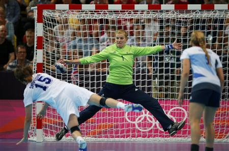 Russia's Natalia Shipilova scores a goal on Britain's goalkeeper Sarah Hargreaves in their women's handball Preliminaries Group A match at the Copper Box venue during the London 2012 Olympic Games July 30, 2012. REUTERS/Marko Djurica