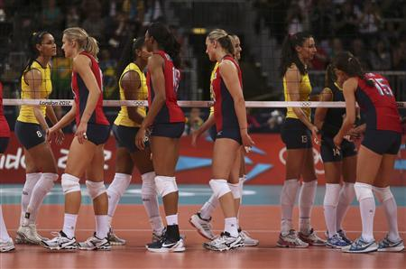 Brazil's players shake hands with the U.S. players (front) after their women's Group B volleyball match at the London 2012 Olympic Games at Earls Court July 30, 2012. REUTERS/Ivan Alvarado