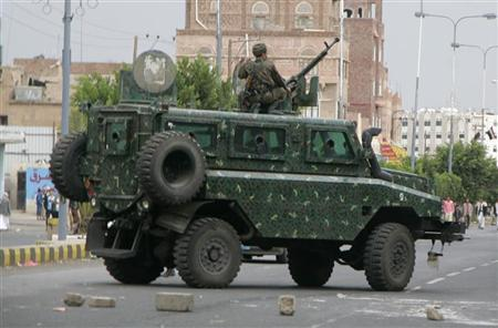 A police armoured personnel carrier patrols following clashes outside the Interior Ministry in Sanaa July 31, 2012. REUTERS/Khaled Abdullah