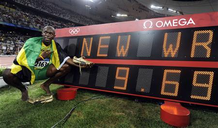 Usain Bolt of Jamaica celebrates winning the men's 100m final of the athletics competition in the National Stadium at the Beijing 2008 Olympic Games in this August 16, 2008 file photo. Bolt won 100 metres gold at the Beijing Olympics in a world record time on Saturday, running 9.69 seconds to claim victory in an exhilarating showdown with his compatriot Asafa Powell. REUTERS/Kai Pfaffenbach