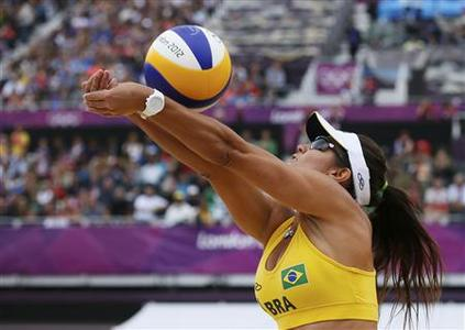 Brazil's Maria Antonelli digs the ball during their women's preliminary round beach volleyball match against Germany at the London 2012 Olympic Games at Horse Guards Parade July 31, 2012. REUTERS/Lucy Nicholson