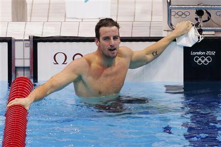 Australia's James Magnussen reacts after finishing first in his men's 100m freestyle semi-finals during the London 2012 Olympic Games at the Aquatics Centre July 31, 2012. REUTERS/Tim Wimborne