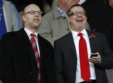 Manchester United board members Avram (L) and Brian Glazer attend the English Premier League soccer match against Manchester City at Old Trafford in Manchester, northern England, October 23, 2011. REUTERS/Darren Staples