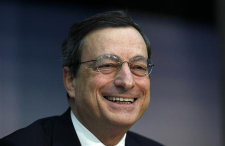 European Central Bank (ECB) President Mario Draghi smiles during the monthly news conference in Frankfurt in this December 8, 2011 file photo. REUTERS/Ralph Orlowski/Files