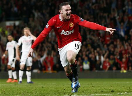 Manchester United's Wayne Rooney celebrates his goal against Fulham during their Premier League match at Old Trafford in Manchester ,northern England, March 26, 2012. REUTERS/Phil Noble