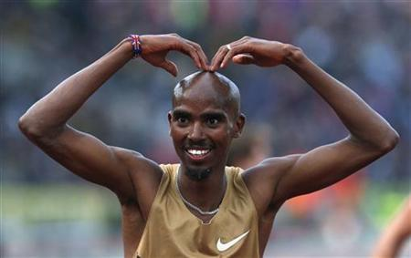 Mo Farah of Britain reacts after winning the men's 5000m during the Diamond League London Grand Prix athletics meet at Crystal Palace in London July 13, 2012. REUTERS/Suzanne Plunkett