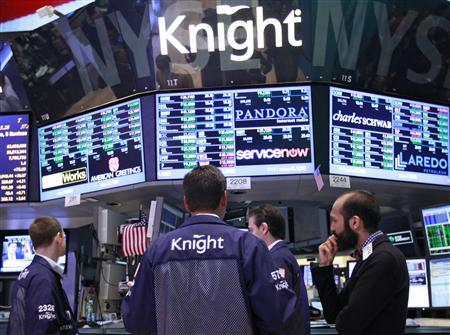 Traders work at the Knight Capital kiosk on the floor of the New York Stock Exchange in this August 3, 2012 file photo. REUTERS/Brendan McDermid/Files