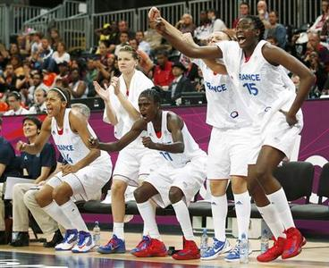 France's women's basketball team members celebrate on the bench during the women's quarterfinal basketball match against Czech Republic at the Basketball Arena in London during the London 2012 Olympic Games August 7, 2012. REUTERS/Sergio Perez