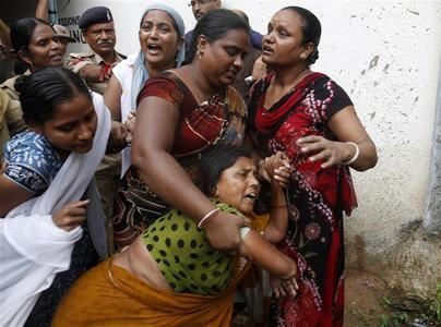 Unidentified relatives of convicted persons wail outside a court in the western Indian city of Ahmedabad August 31, 2012. A former Indian state minister and 30 others were jailed for their role in the so-called Naroda Patiya massacre, the single bloodiest episode of the three-day riots. REUTERS/Amit Dave