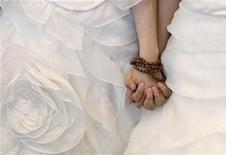 <p>Une majorité de Français sont favorables au mariage homosexuel mais ce soutien recule, de même que sur le droit à l'adoption pour les couples de même sexe, indique un sondage BVA pour Le Parisien. /Photo d'archives/REUTERS/Pichi Chuang</p>
