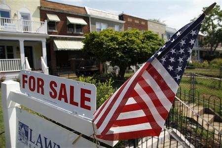 A U.S. flag decorates a for-sale sign at a home in the Capitol Hill neighborhood of Washington, DC in this August 21, 2012 file photograph. REUTERS/Jonathan Ernst/Files